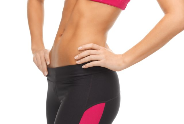 close up picture of woman trained abs