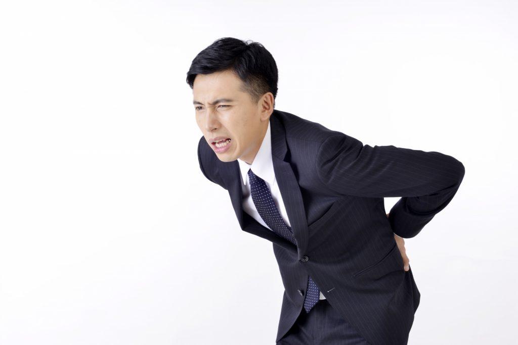 腰痛のサラリーマン