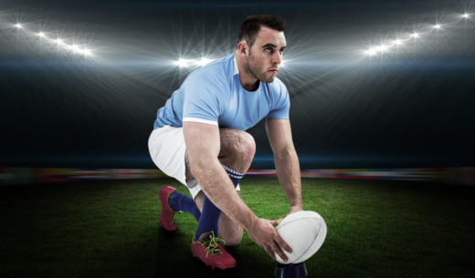 ボールを置いているラグビー選手